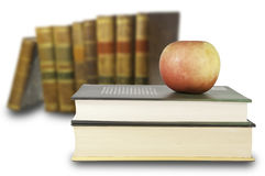 Studies and healthy eating. This image shows several books with an apple. Healthy eating coupled with studies Royalty Free Stock Photos