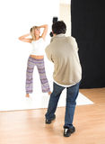 Studio. Photographer and young blond girl Stock Images