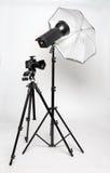 The studio. Professional camera and studio flash with umbrella Royalty Free Stock Photo