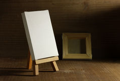 Studio. Painter with easel and canvas, old wood royalty free stock photography