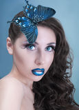 Studio beauty portrait with blue butterfly Stock Image