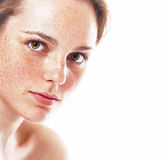 Studio beauty. Portrait of smiling young and happy woman with freckles. Isolated on white. Royalty Free Stock Image