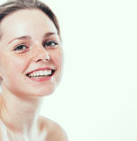 Studio beauty. Portrait of smiling young and happy woman with freckles. Isolated on white. Royalty Free Stock Photography