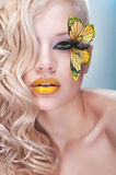 Studio beauty portrait with yellow butterfly. Studio beauty portrait of woman with yellow butterfly stock photography