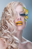 Studio beauty portrait with yellow butterfly. Studio beauty portrait of woman with yellow butterfly stock image
