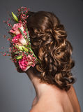 studio beauty shoot of bride hairtyle with flowers Stock Photos