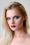 Studio beauty shot: closeup portrait of attractive young woman. Stock Image