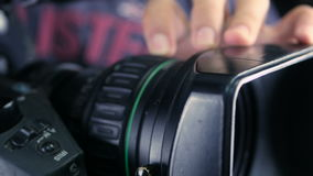Studio camera. Cameraman changing camera settings focal length, aperture and zoom preparing for shooting. stock video footage