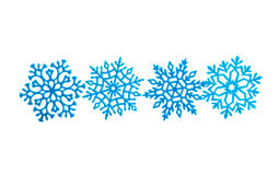 Studio close-up of a bright blue snowflake ornament Stock Images
