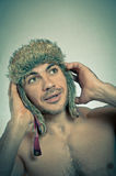Studio closeup colorful portrait of young glamour sportive hipster man in stylish fur hat with crazy emotions. Vintage toned. Royalty Free Stock Photography