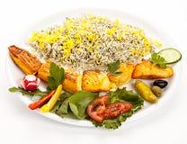 Studio Closeup Of Grilled Salmon Kebab On White royalty free stock image