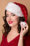 Studio closeup portrait of a beautiful girl  in the hat of Santa Claus, Stock Photography