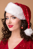 Studio closeup portrait of a beautiful girl  in the hat of Santa Claus, Royalty Free Stock Photos