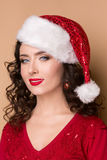 Studio closeup portrait of a beautiful girl  in the hat of Santa Claus, Royalty Free Stock Photography
