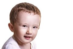 Studio closeup portrait of little baby boy looking playful to th Royalty Free Stock Images