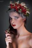 Studio conceptual female beauty portrait with rowa Royalty Free Stock Photos