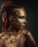 Studio conceptual female bronze beauty portrait Stock Image