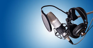 Studio condenser microphone and equipment blue  Stock Image
