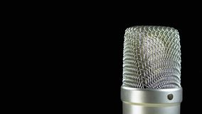 Studio Condenser Microphone Rotates on a Black Background stock footage