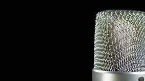 Studio Condenser Microphone Rotates on a Black Background stock video