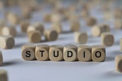 Studio - cube with letters, sign with wooden cubes. Studio - wooden cubes with the inscription `cube with letters, sign with wooden cubes`. This image belongs to Stock Image