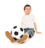 Studio de garçon du football d'isolement Images stock