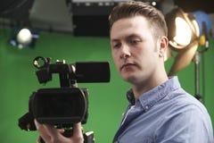 Studio di Working In Television del cineoperatore fotografie stock