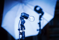 Studio Equipment. Incandescent, flash and photo umbrella Royalty Free Stock Image