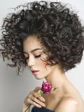 Beautiful young woman with rose. Studio fashion photo of beautiful young woman with violet rose.  Valentines day. Spring blossom Royalty Free Stock Images