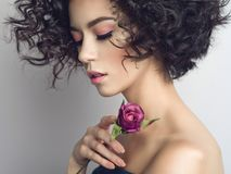 Beautiful young woman with rose. Studio fashion photo of beautiful young woman with violet rose.  Valentines day. Spring blossom Stock Images