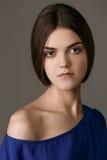 Studio fashion photo of elegant beautiful lady in blue dress. Portrait Stock Images