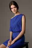 Studio fashion photo of elegant beautiful lady in blue dress. Portrait Royalty Free Stock Image