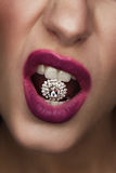 Studio fashion portrait of attractive woman with gemstone in her. Mouth Stock Photos