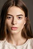Studio fashion portrait of yong pretty woman. Gray Stock Image