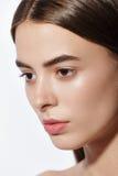 Studio fashion portrait of yong pretty woman. White background Stock Photo