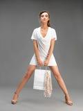 Studio, fashion portrait, young woman shopping Stock Image