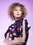 Studio fashion portrait of a young woman in a sparkly dress. Beatiful curly hair. Studio fashion portrait of a young woman in a sparkly dress. Beautiful curly stock images
