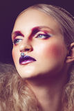 Studio fashion shoot of beauty woman with creative make-up and h Royalty Free Stock Images