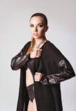 Studio fashion shot: a beautiful sexy girl wearing black sweater Stock Photo