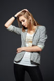 Studio fashion shot: beautiful young girl in leggings, jacket and shirt Royalty Free Stock Photos