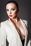 Studio fashion shot: beautiful young girl in white jacket Royalty Free Stock Photos