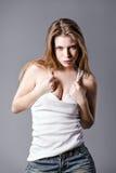 Studio fashion shot: beautiful young woman in shirt and denim shorts Stock Photos