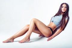 Studio fashion shot of beautiful young woman in shirt and panties Royalty Free Stock Photos