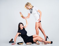 Studio fashion shot: confrontation of two lovely women Royalty Free Stock Photography