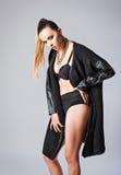 Studio fashion shot: cool sexy girl wearing black sweater Royalty Free Stock Image