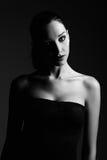 Studio fashion shot: dramatic portrait of beautiful young woman. Royalty Free Stock Photo