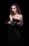 Studio fashion shot: dramatic portrait of sexy beautiful young woman in black dress Royalty Free Stock Photo
