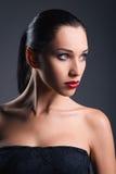 Studio fashion shot: portrait of beautiful young woman Royalty Free Stock Photos