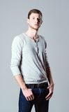 Studio fashion shot: portrait of handsome young man wearing jeans and shirt Stock Image