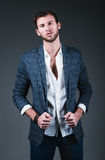 Studio fashion shot: portrait of handsome young man wearing jeans, shirt and jacket Royalty Free Stock Images